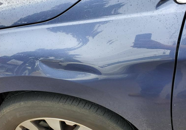 dent in a car before fixing